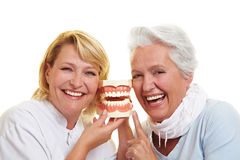 http://www.dreamstime.com/royalty-free-stock-images-smiling-dentist-senior-woman-image21122749
